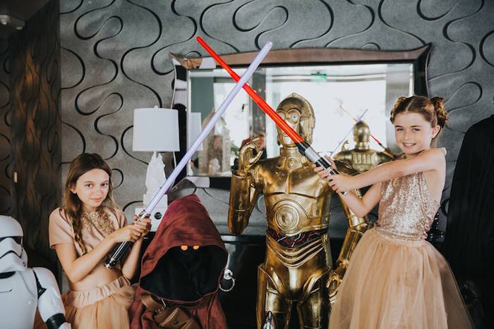 Birthday girls dueling it out at their Galactic Star Wars Themed Birthday Party via Kara's Party Ideas   KarasPartyIdeas.com (16)