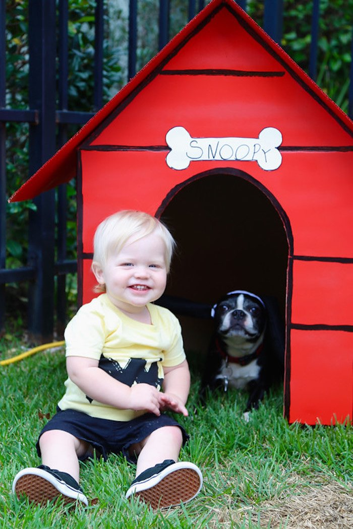Birthday Boy in front of Snoopy's Dog House from a Peanuts + Charlie Brown Birthday Party via Kara's Party Ideas | KarasPartyIdeas.com (34)