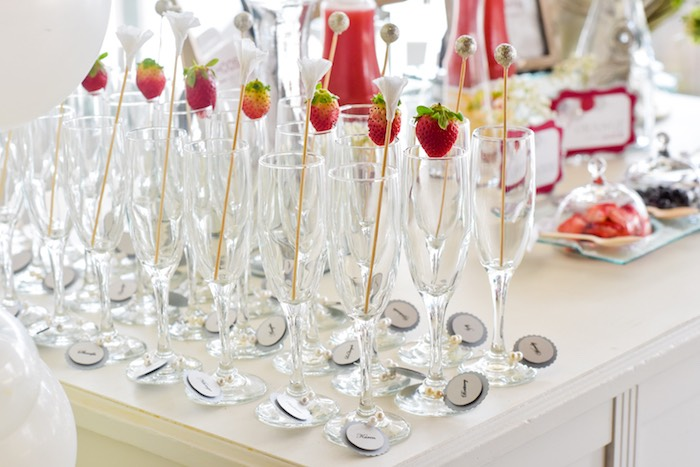 champagne glasses from a pearls of wisdom bridal shower via karas party ideas karaspartyideas
