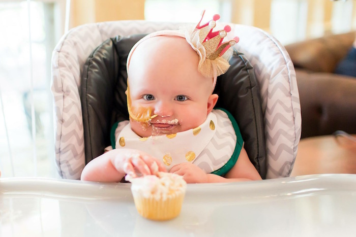 Birthday Girl with her Cupcake from a Pink & Gold Cancer-Free 1st Birthday Party via Kara's Party Ideas | KarasPartyIdeas.com (5)