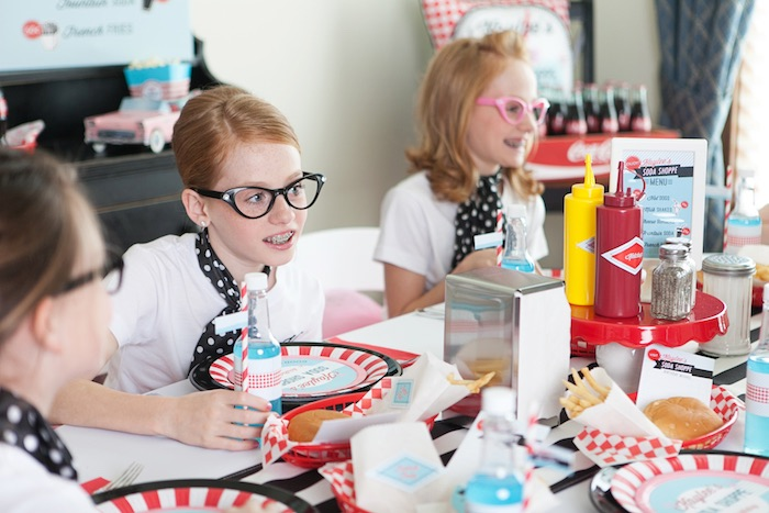 Party goers sitting down to eat at a Retro Soda Shoppe Birthday Party via Kara's Party Ideas - The Place for All Things Party! KarasPartyIdeas.com (23)