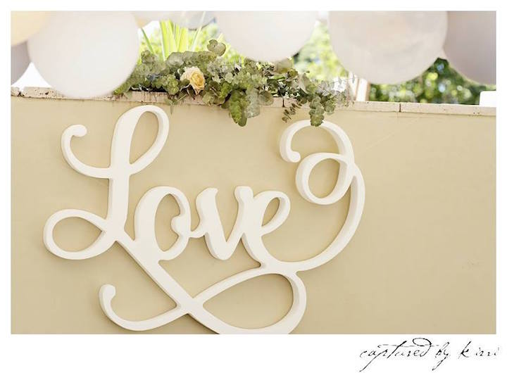 """Love"" Sign from a Rustic Outdoor Bridal Shower via Kara's Party Ideas 
