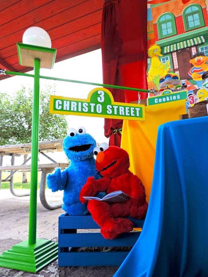 Elmo & Cookie Monster sitting beneath the iconic Sesame Street-inspired Light Post from a Rustic Whimsical Sesame Street Birthday Party via Kara's Party Ideas | KarasPartyIdeas.com (40)
