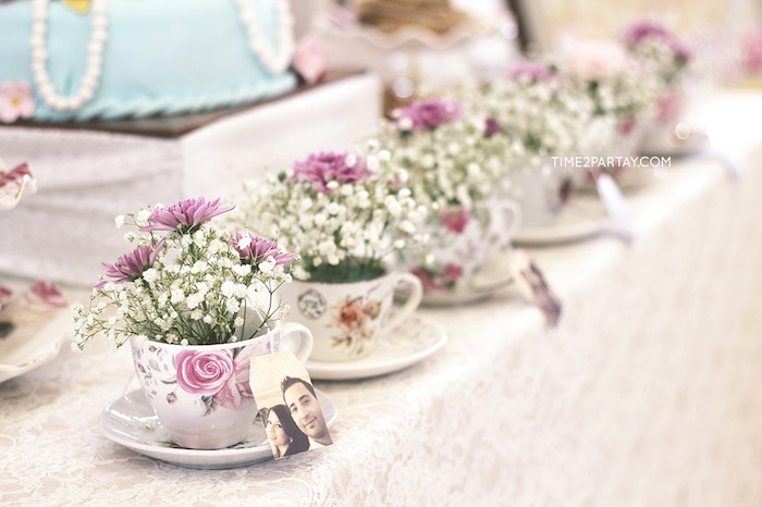 tea cup floral arrangements from an afternoon tea bridal shower via karas party ideas karaspartyideas