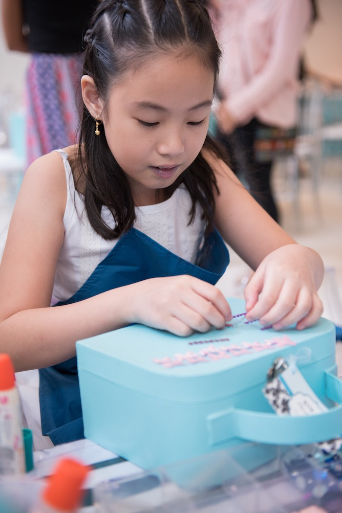 Little Girl decorating her Tiffany's Luggage Box from a Breakfast at Tiffany's Inspired Birthday Party via Kara's Party Ideas | KarasPartyIdeas.com (12)
