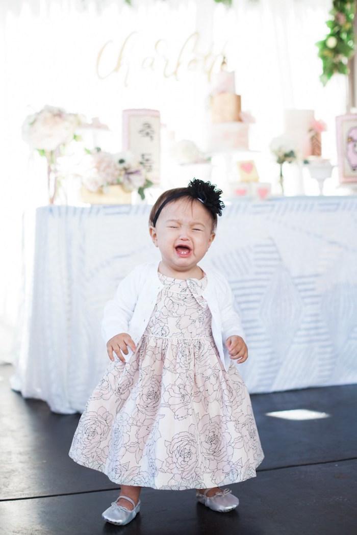 Birthday girl tears from a Chic Tropical Hawaiian Themed Birthday Party via Kara's Party Ideas KarasPartyIdeas.com (17)