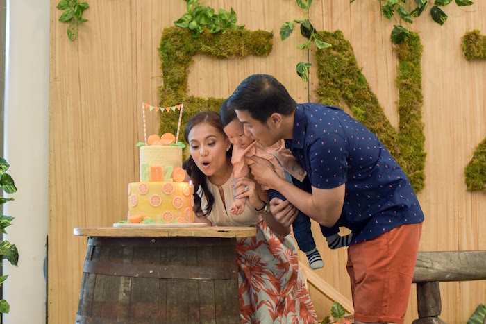 Birthday Boy blowing out the candles at his Citrus Harvest Birthday Party via Kara's Party Ideas! KarasPartyIdeas.com (29)