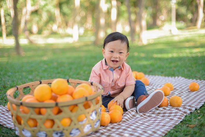 Birthday Boy with a basket full of oranges from a Citrus Harvest Birthday Party via Kara's Party Ideas! KarasPartyIdeas.com (9)