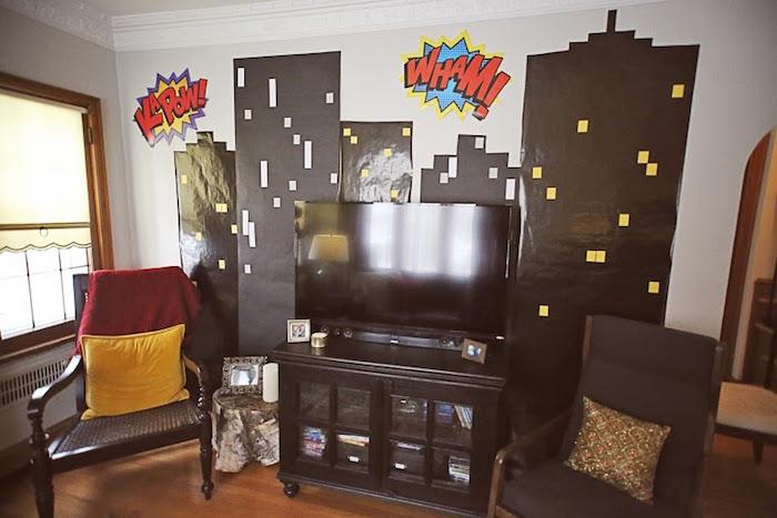 Cityscape party backdrop from a Comic Book Superhero Joint Birthday Party via Kara's Party Ideas | KarasPartyIdeas.com (22)
