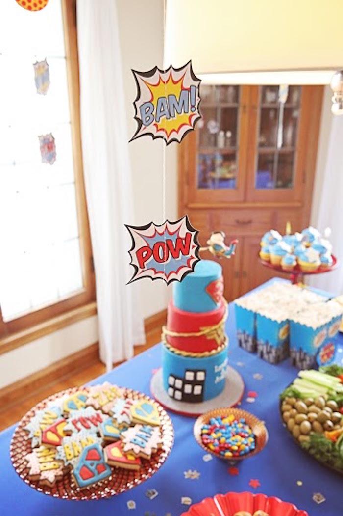 Hanging superhero expression bubbles from a Comic Book Superhero Joint Birthday Party via Kara's Party Ideas | KarasPartyIdeas.com (12)