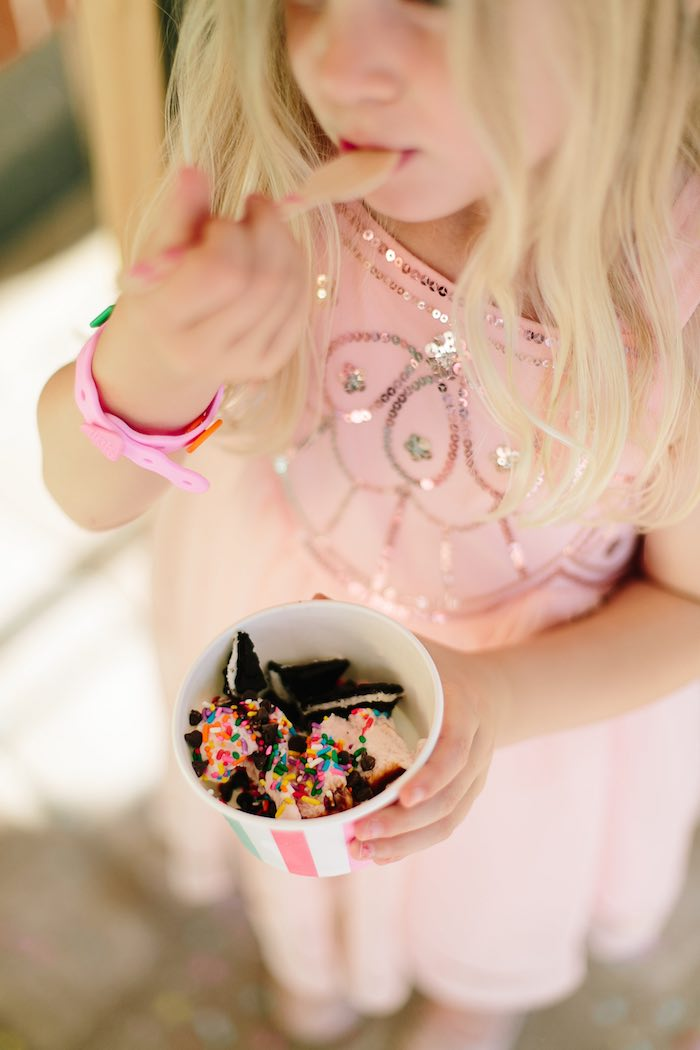 Eating ice cream from a Confetti Inspired Ice Cream Birthday Party via Kara's Party Ideas | KarasPartyIdeas.com (3)