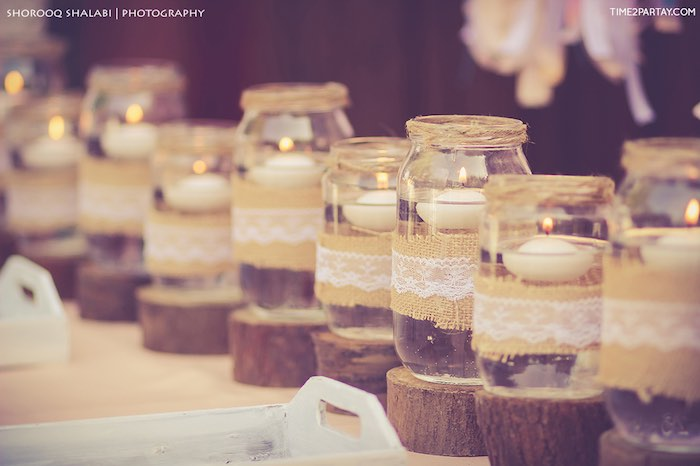 Floating candles placed in mason jars from a Dream Catcher Baby Shower via Kara's Party Ideas | KarasPartyIdeas.com (34)