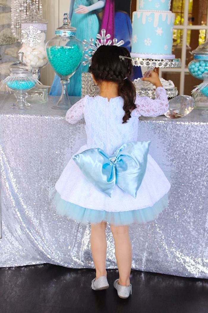 Birthday girl's dress back from a Frozen Themed Joint Birthday Party via Kara's Party Ideas | KarasPartyIdeas.com (18)