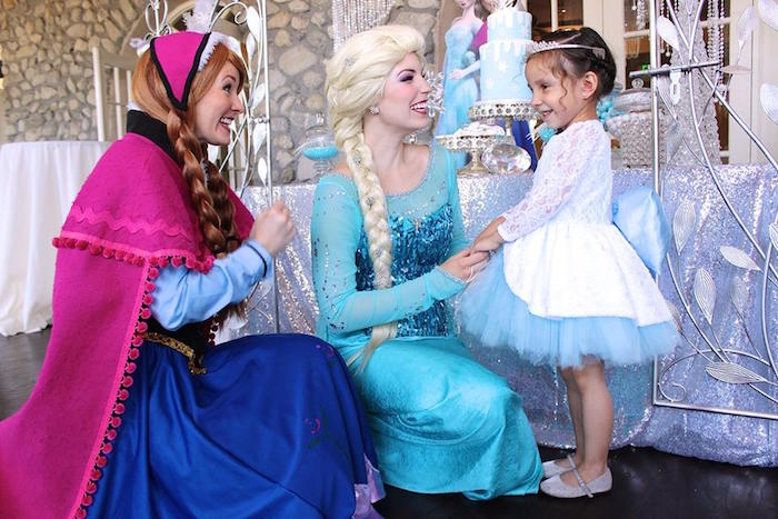 The birthday girl with Elsa & Anna from a Frozen Themed Joint Birthday Party via Kara's Party Ideas | KarasPartyIdeas.com (16)
