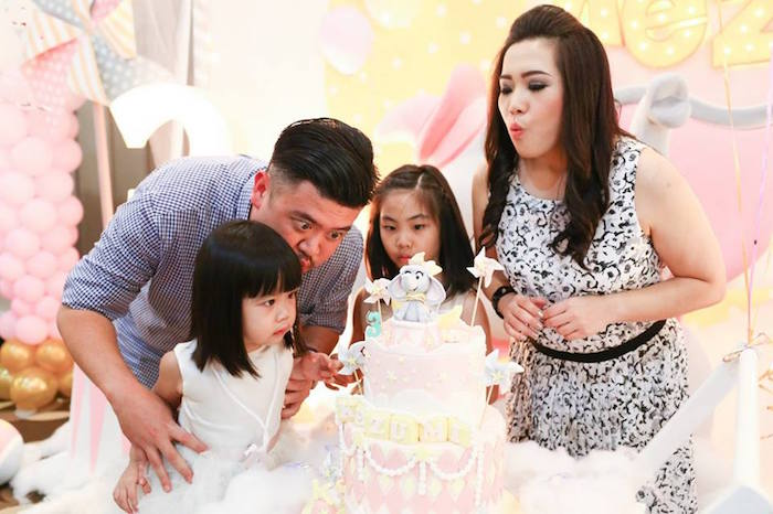 Blowing out the candles from a Girly Circus + Dumbo Birthday Party via Kara's Party Ideas | KarasPartyIdeas.com (6)