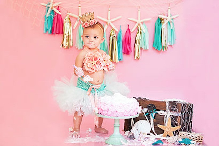 A Littlest Mermaid smash cake photo shoot from a Littlest Mermaid 1st Birthday Party via Kara's Party Ideas | KarasPartyIdeas.com - The Place for All Things Party! (26)