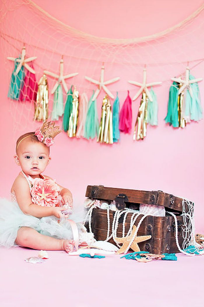 Littlest Mermaid photo shoot from a Littlest Mermaid 1st Birthday Party via Kara's Party Ideas | KarasPartyIdeas.com - The Place for All Things Party! (25)