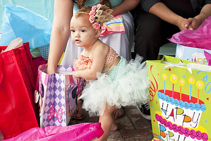 Mermaid (birthday girl) opening her gifts from a Littlest Mermaid 1st Birthday Party via Kara's Party Ideas | KarasPartyIdeas.com - The Place for All Things Party! (21)