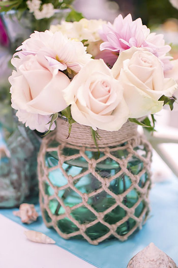 Netted twine flower centerpiece from a Littlest Mermaid 1st Birthday Party via Kara's Party Ideas | KarasPartyIdeas.com - The Place for All Things Party! (17)