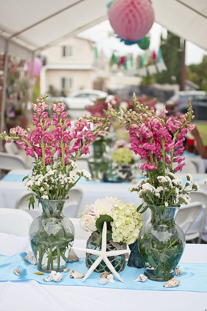 Guest table centerpieces from a Littlest Mermaid 1st Birthday Party via Kara's Party Ideas | KarasPartyIdeas.com - The Place for All Things Party! (8)
