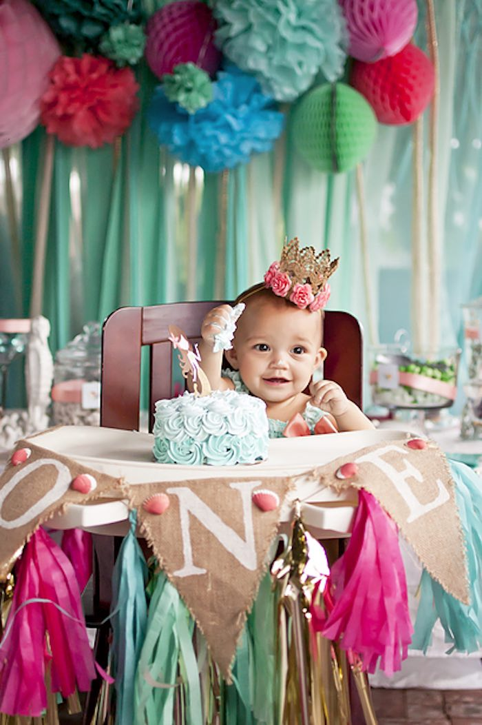 Birthday girl enjoying her smash cake from a Littlest Mermaid 1st Birthday Party via Kara's Party Ideas | KarasPartyIdeas.com - The Place for All Things Party! (34)