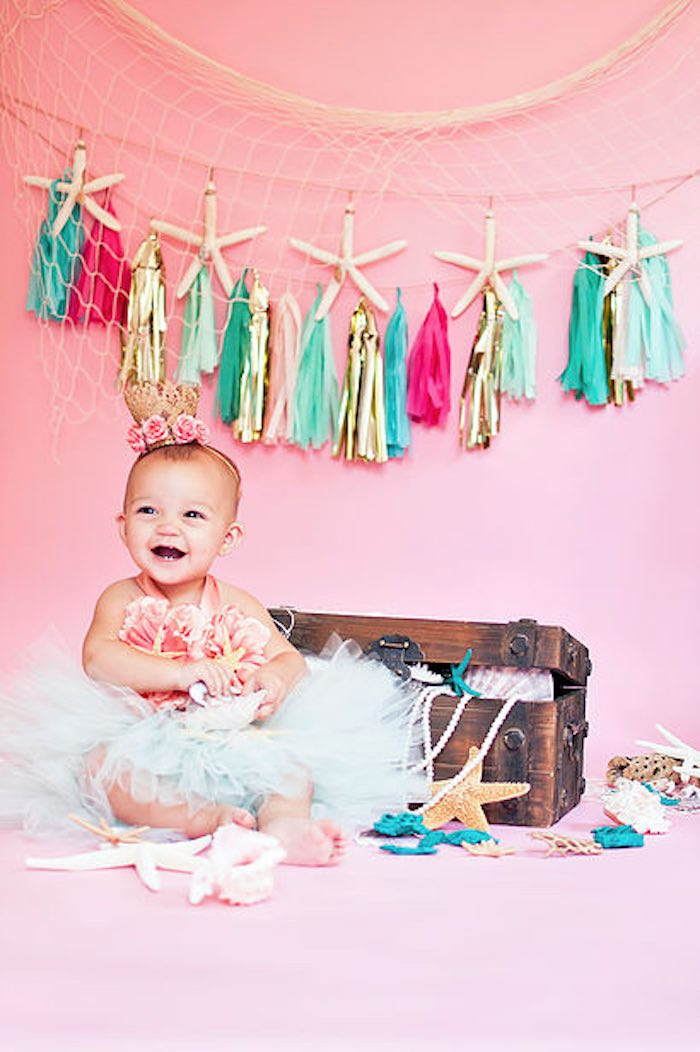 Birthday girl dressed to impress for her Littlest Mermaid photo shoot from a Littlest Mermaid 1st Birthday Party via Kara's Party Ideas | KarasPartyIdeas.com - The Place for All Things Party! (30)
