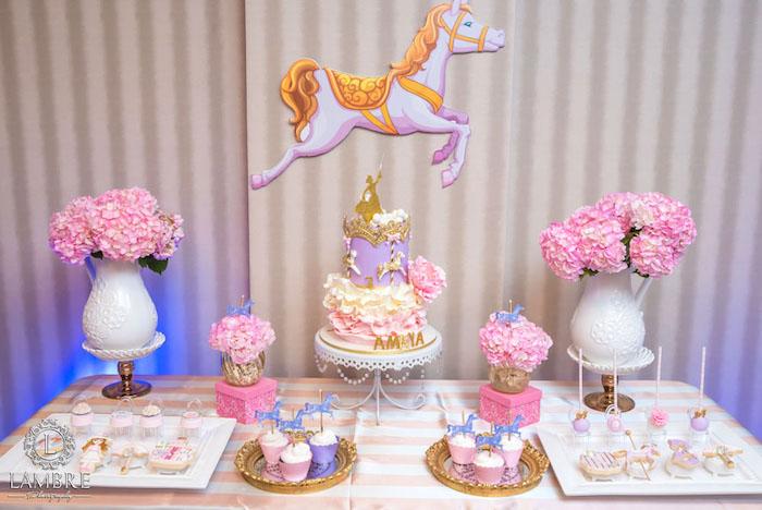 cake table from a mary poppins carousel themed birthday party via karas party ideas karaspartyideas