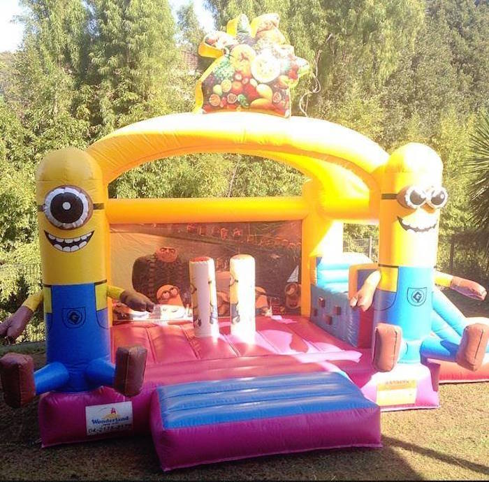 Minion bounce house from a Minions Birthday Party via Kara's Party Ideas   KarasPartyIdeas.com (13)