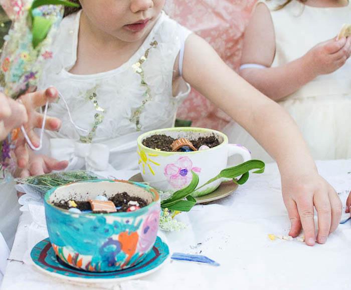 Little Pixies creating Fairy Garden Tea Cups from a Pastel Fairy Themed Birthday Party via Kara's Party Ideas | KarasPartyIdeas.com (11)