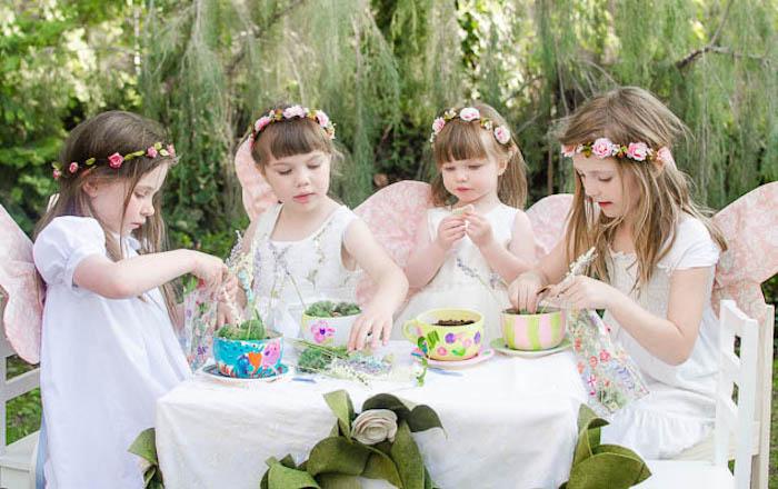 Party Goers Creating Fairy Garden Tea Cups from a Pastel Fairy Themed Birthday Party via Kara's Party Ideas | KarasPartyIdeas.com (8)