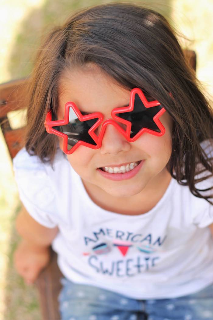 Little girl from a Red + White & Blue Outdoor Summer 4th of July Celebration via Kara's Party Ideas - KarasPartyIdeas.com (69)