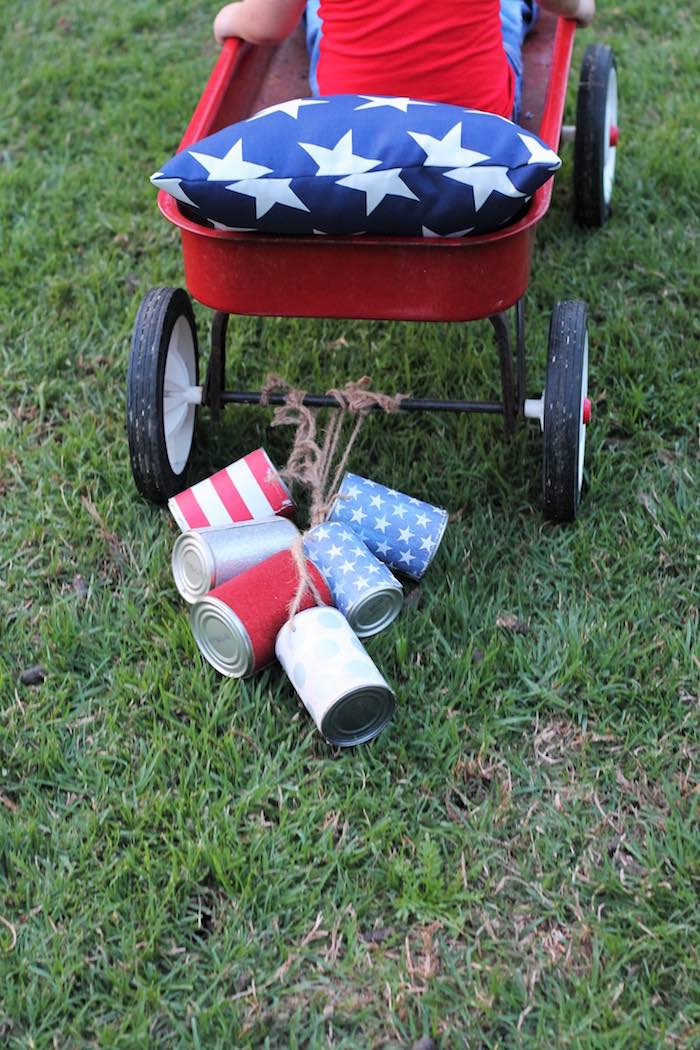 Wagon with can streamers from a Red + White & Blue Outdoor Summer 4th of July Celebration via Kara's Party Ideas - KarasPartyIdeas.com (64)