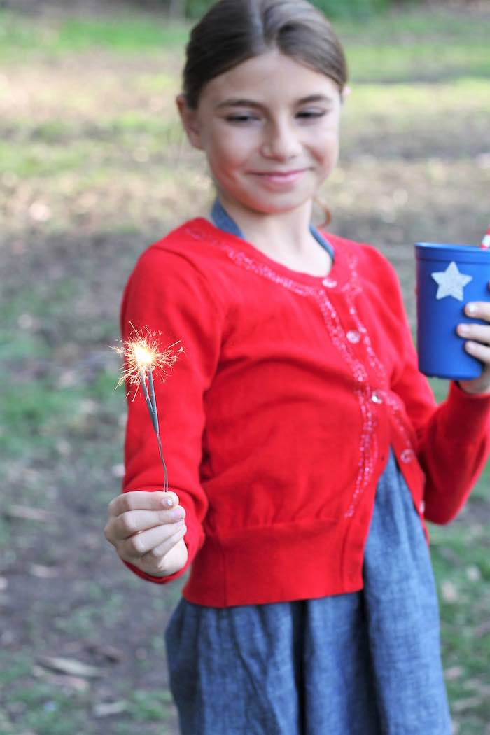 Sparkler fun from a Red + White & Blue Outdoor Summer 4th of July Celebration via Kara's Party Ideas - KarasPartyIdeas.com (20)