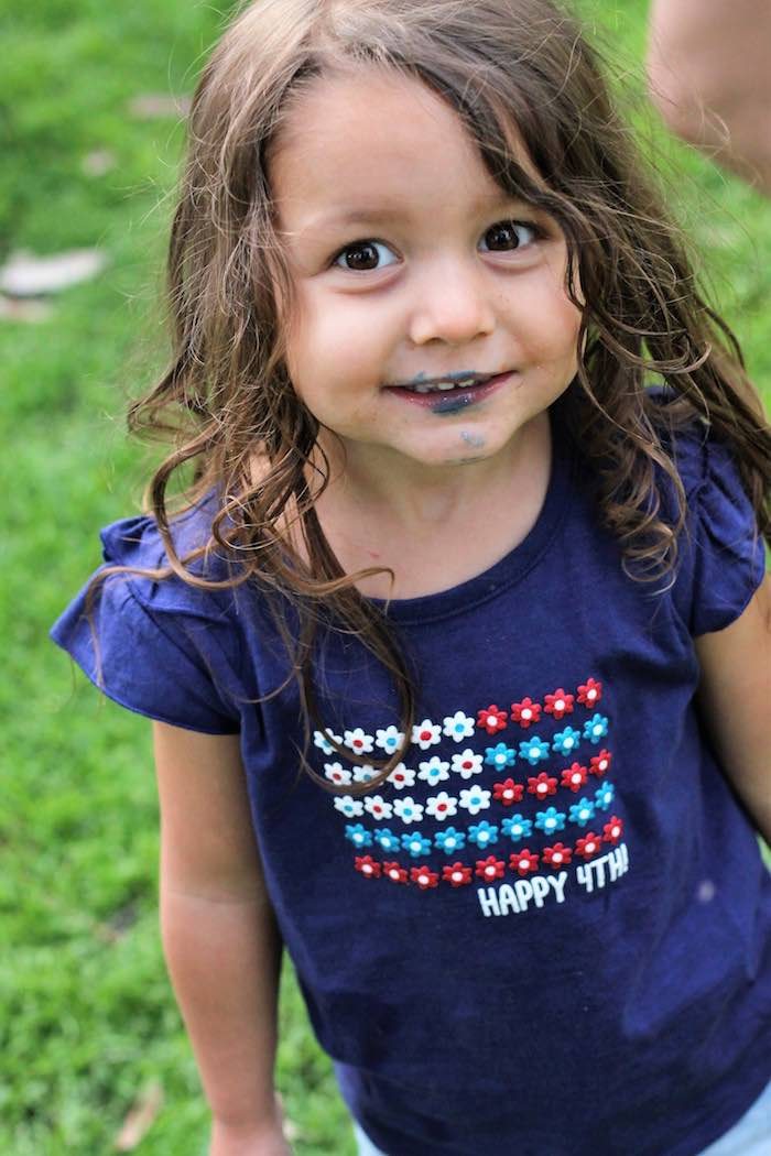 Little girl from a Red + White & Blue Outdoor Summer 4th of July Celebration via Kara's Party Ideas - KarasPartyIdeas.com (18)