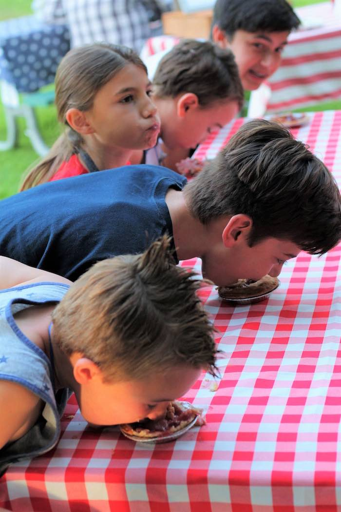 Pie eating contest from a Red + White & Blue Outdoor Summer 4th of July Celebration via Kara's Party Ideas - KarasPartyIdeas.com (10)