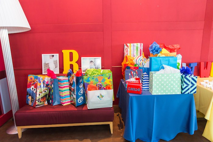 Gift area + table from a Sesame Street Birthday Party via Kara's Party Ideas | KarasPartyIdeas.com - The Place for All Things Party! (12)