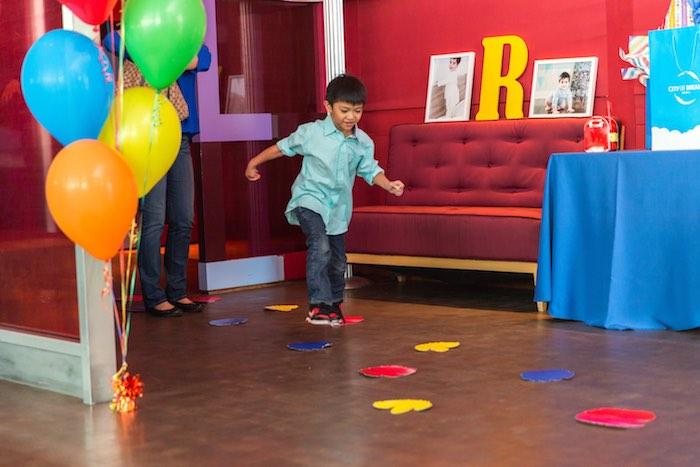 Little boy following footprints to a Sesame Street Birthday Party via Kara's Party Ideas | KarasPartyIdeas.com - The Place for All Things Party! (8)