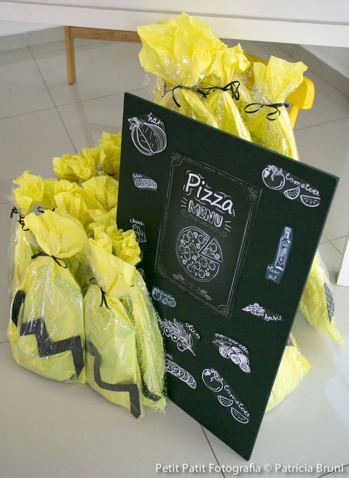 Chalkboard Sign + Charlie Brown-inspired Favor Bags from a Snoopy Pizza Themed Birthday Party via Kara's Party Ideas | KarasPartyIdeas.com
