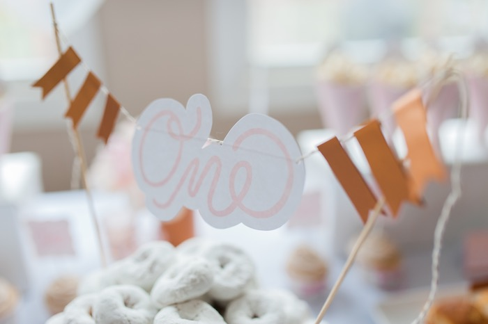 Donut cake bunting from a Sugar & Spice 1st Birthday Party via Kara's Party Ideas | KarasPartyIdeas.com - THE PLACE FOR ALL THINGS PARTY! (6)