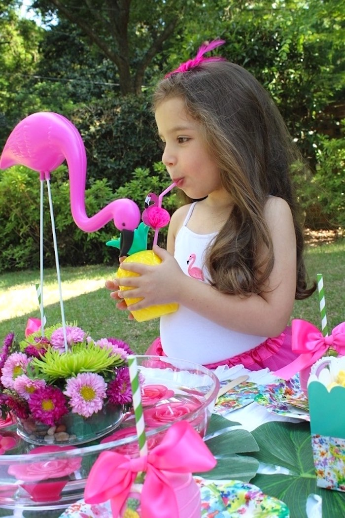 Little girl drinking from a pineapple cup from a Tropical Flamingo Themed Birthday Party via Kara's Party Ideas | KarasPartyIdeas.com - The Place for All Things Party! (32)