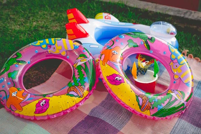 Blow-up tubes from a Tropical Surf Themed Birthday Party via Kara's Party Ideas | KarasPartyIdeas.com (10)