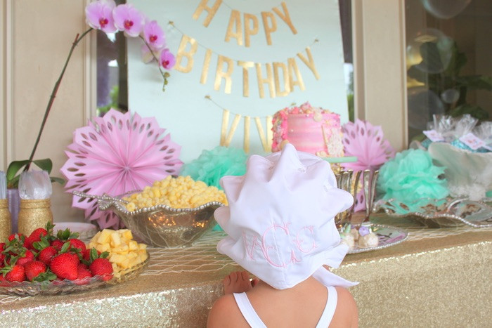 Sea shell-inspired hat worn by the birthday girl from an Under the Sea Birthday Pool Party via Kara's Party Ideas | KarasPartyIdeas.com (16)