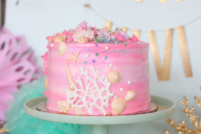 Adorable sea shell covered pink birthday cake from an Under the Sea Birthday Pool Party via Kara's Party Ideas | KarasPartyIdeas.com (13)