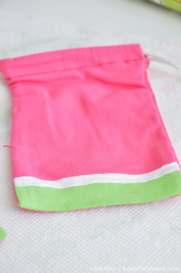 Watermelon themed DIY birthday party favor bag by Kara's Party Ideas | Kara Allen | KarasPartyIdeas.com #MichaelsMakers You're one in a melon! 2