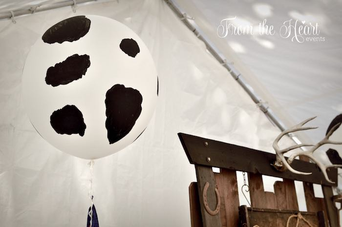 Giant floating cow print balloon from a Wild West Cowboy Party via Kara's Party Ideas | KarasPartyIdeas.com - The Place for All Things Party! (18)