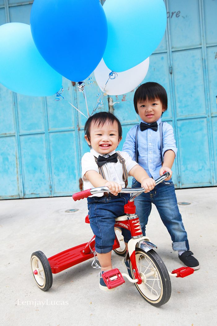 Birthday boy riding a tricycle from a Vintage Bicycle + Tricycle Themed 1st Birthday Party via Kara's Party Ideas | KarasPartyIdeas.com (31)