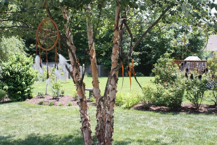 Hanging tribal decor from a 1st Birthday Pow Wow via Kara's Party Ideas | KarasPartyIdeas.com (17)