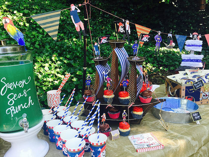 Pirate party table from A Pirate's Life Outdoor Pool Party via Kara's Party Ideas! Full of party ideas, cakes, decor, printables and more! KarasPartyIdeas.com (5)