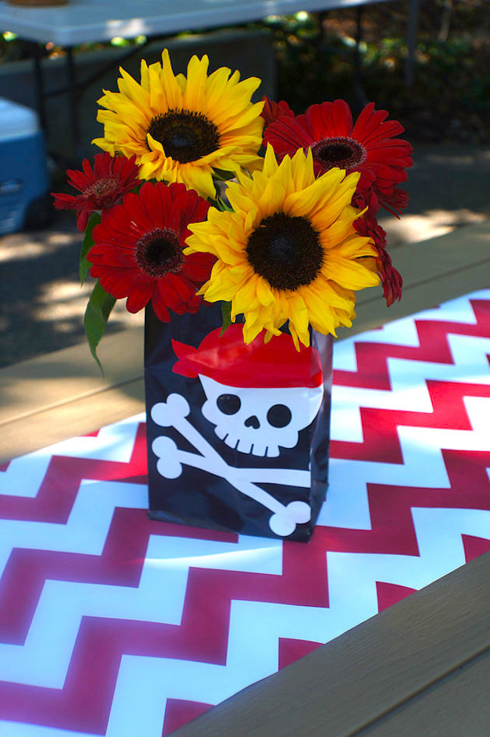 Pirate floral arrangement from A Pirate's Life Outdoor Pool Party via Kara's Party Ideas! Full of party ideas, cakes, decor, printables and more! KarasPartyIdeas.com (11)