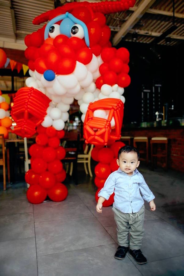 Birthday boy & airplane balloon creation from an Airplane Themed Birthday Party via Kara's Party Ideas | KarasPartyIdeas.com (24)